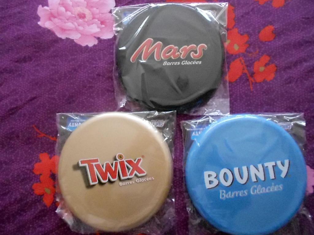 1 Frisbee offert pour l'achat de deux produits de la marque (Twix, Mars, Bounty, Snickers)