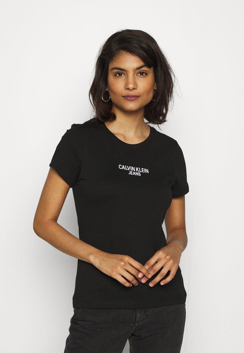 T-shirt Calvin Klein Jeans Institutional Back Logo - Noir ou Blanc, Toutes tailles