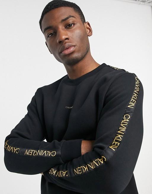 Sweat-shirt à logo central doré et bandes logo Calvin Klein - Noir, XS au XL